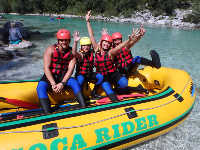 Girl is having fun on full day river rafting Slovenia tour